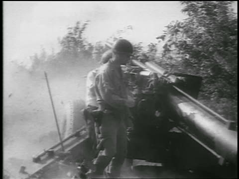 b/w 1950 group of soldiers shooting howitzer in korean war / newsreel - korean war stock videos & royalty-free footage