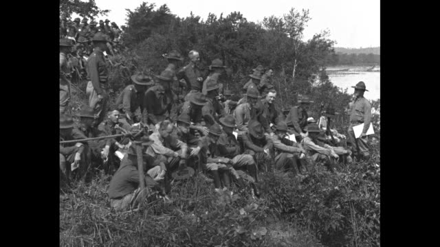 group of soldiers sitting being told about construction of pontoon bridge / soldiers laying wood slats to build bridge across boats / completed... - pontoon bridge stock videos and b-roll footage