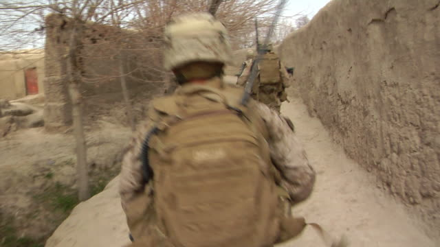 group of soldiers walking in row / musa qala, helmand province, afghanistan. - 2009 stock videos & royalty-free footage
