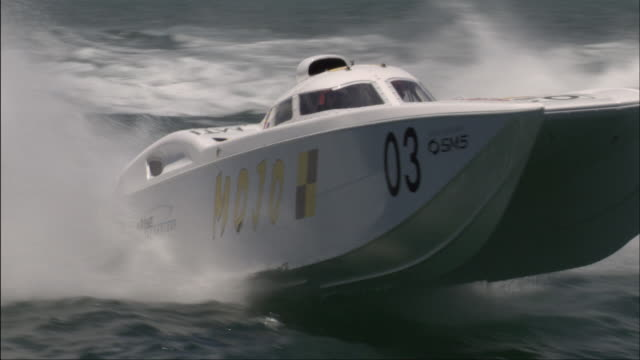 ms pan group of speedboats moving racing past camera/ miami, florida - medium group of objects stock videos & royalty-free footage