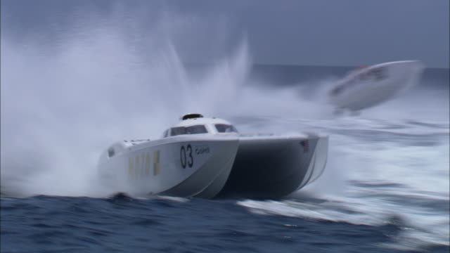 ms pan group of speedboats moving toward camera/ miami, florida - medium group of objects stock videos & royalty-free footage