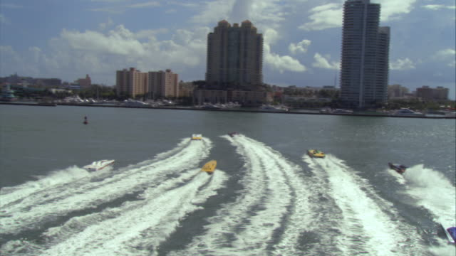aerial group of speedboats moving toward marina/ miami, florida - medium group of objects stock videos & royalty-free footage