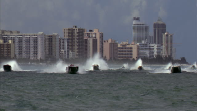 aerial group of speedboats off coast with skyline in background/ miami, florida - medium group of objects stock videos & royalty-free footage