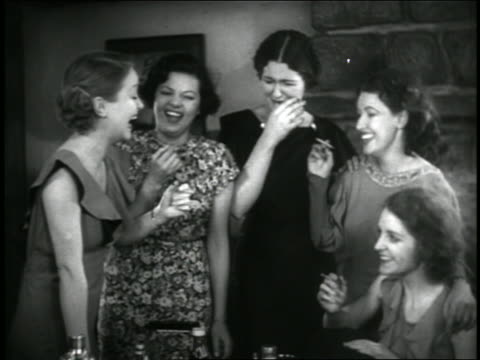 b/w 1936 group of stoned hispanic woman smoking + laughing (1 may be sara garcia) / feature - mull stock videos & royalty-free footage