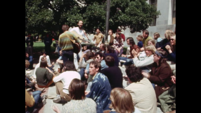 group of student anti-war demonstrators singing songs at protest at the university of california berkeley in 1970. - vietnam war stock videos & royalty-free footage