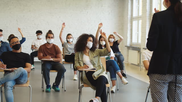 group of students at lecture during coronavirus pandemic - university stock videos & royalty-free footage