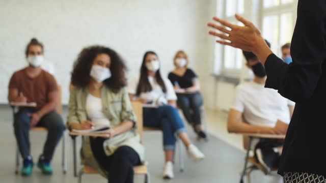 group of students at lecture during coronavirus pandemic - professor stock videos & royalty-free footage
