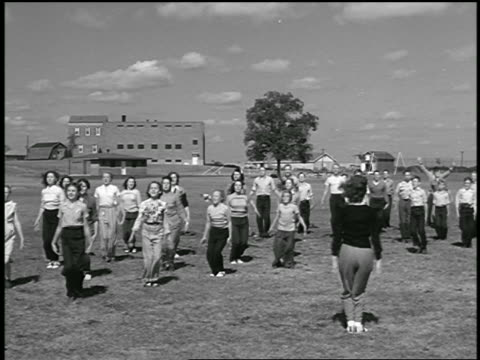 b/w 1946 group of students doing jumping jacks during gym class outdoors - schoolboy stock videos and b-roll footage