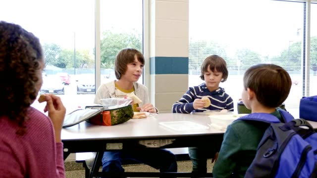 group of students have lunch together in school cafeteria - lunch stock videos & royalty-free footage