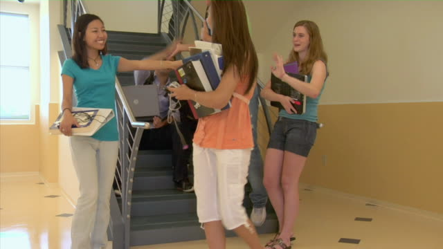 ms, group of students in college corridor, san antonio, texas, usa - barefoot stock videos & royalty-free footage
