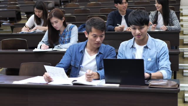 group of students in lecture hall in asia - brainstorming and working on project - seminar stock videos & royalty-free footage