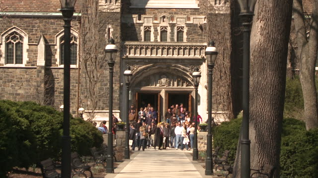 ws group of students leaving university building and gathering outside exit door, bethlehem, pennsylvania, usa - see other clips from this shoot 1503 stock videos and b-roll footage