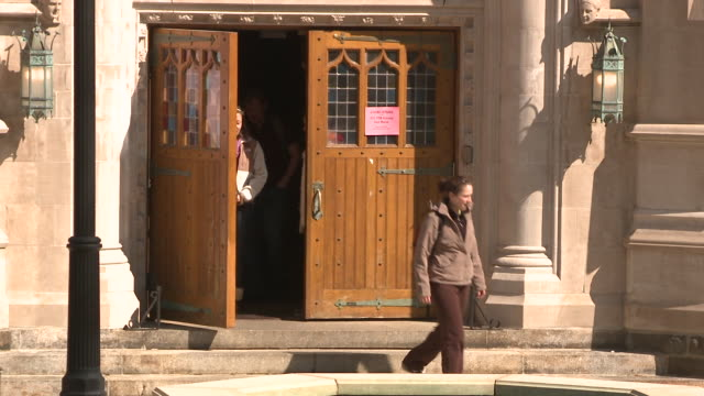 ms ha group of students leaving university building through wooden door, bethlehem, pennsylvania, usa - see other clips from this shoot 1503 stock videos and b-roll footage