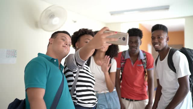group of students taking a selfie at school - female high school student stock videos & royalty-free footage
