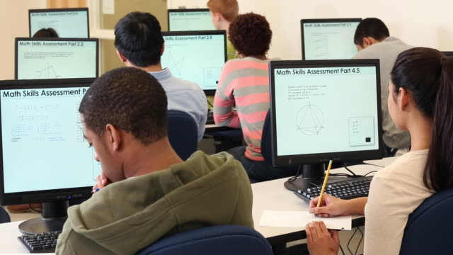 ms ds group of students taking standardized math test on computers / richmond, virginia, united states - 試験点の映像素材/bロール