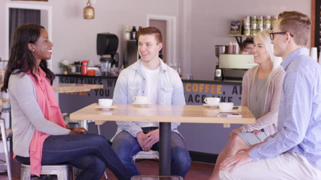 group of students working together in a coffee shop - fatcamera stock videos & royalty-free footage