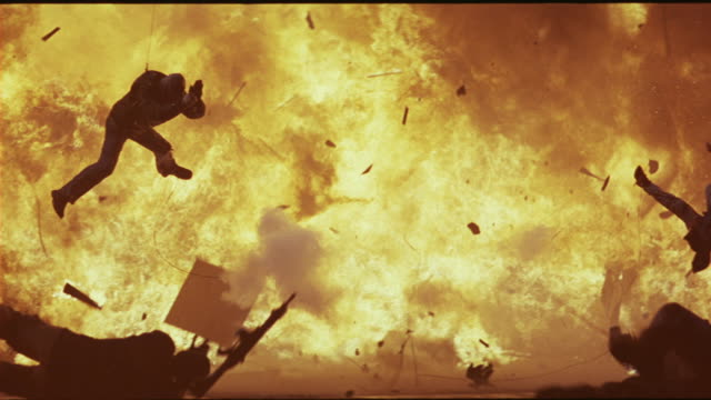 a group of stunt men fly into the air shortly after a jeep explodes. - exploding stock videos & royalty-free footage