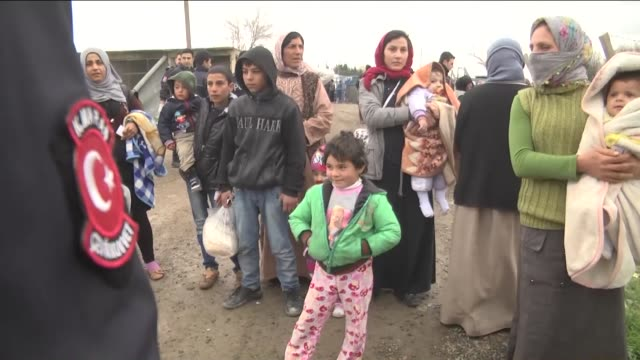 a group of syrian kurds sheltering in turkey after fleeing their homes due to the clashes between islamic state of iraq and levant and kurdish armed... - hometown stock videos and b-roll footage
