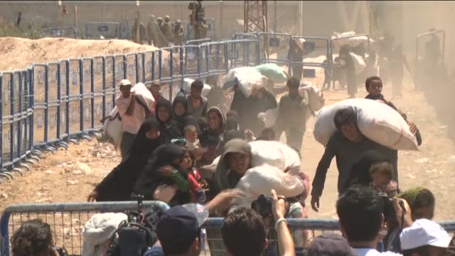 A group of Syrians fled from clashes cross TurkishSyrian border to take shelter in Turkey on June 17 2015 in Sanliurfa's Akcakale district Turkey...