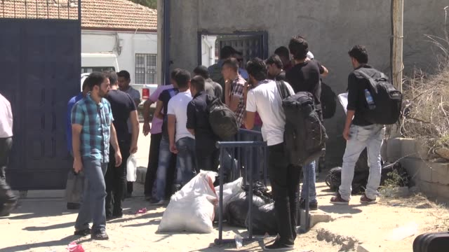 A group of Syrians fled from cruelty of Daesh in Jarabulus wait for crossing the Karkamis Bordergate to return their hometown Jarabulus after cleared...