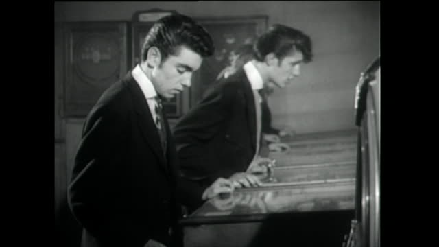 group of teddy boys play on pinball machines; 1955 - 1955 stock videos & royalty-free footage