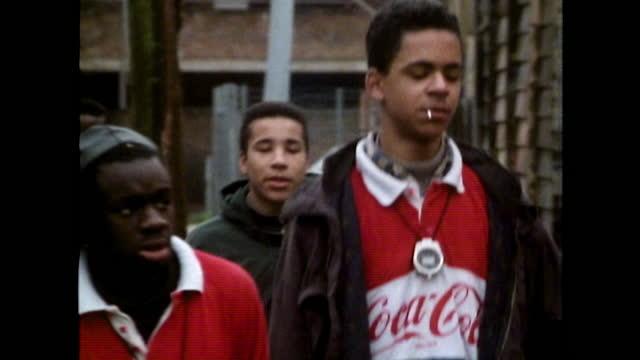 group of teenage boys cross a street in london; 1989 - cap stock videos & royalty-free footage