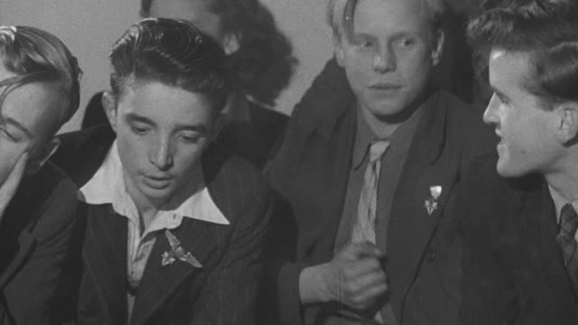 1947 montage group of teenage girls and boys laughing, talking, and smoking / united kingdom - smoking stock-videos und b-roll-filmmaterial
