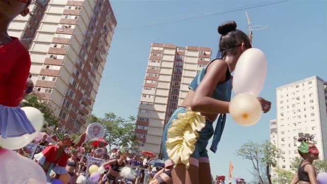 CU, LA, Group of teenage girls (13-14, 14-15) dancing in street parade, Santiago de Cuba, Cuba