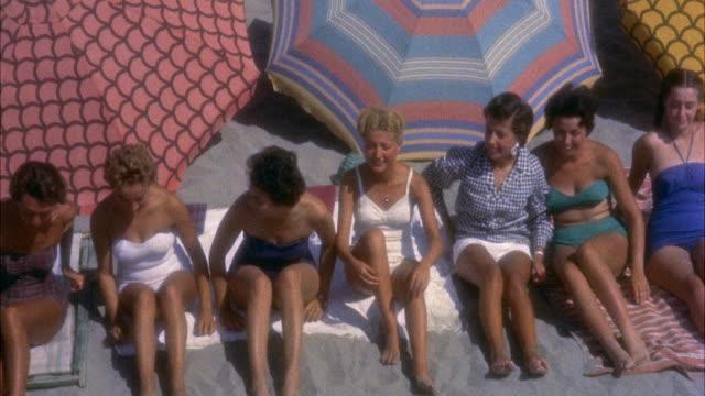 stockvideo's en b-roll-footage met ms group of teenage girls sunbathing on beach,viareggio's sandy beach, tuscany, italy. - zonwering