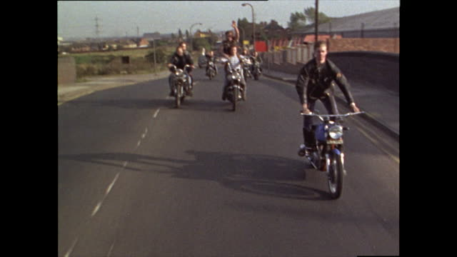group of teenage hell's angels ride motorbikes; 1969 - in front of stock videos & royalty-free footage