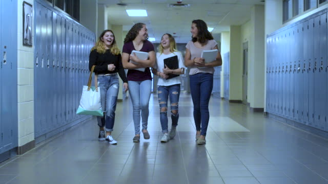 group of teenaged girls walking down school hallway. - female high school student stock videos & royalty-free footage
