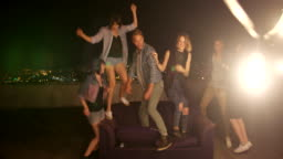 Group of Teenager dancing on a rooftop and have fun