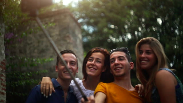 Group of teenager selfie stick