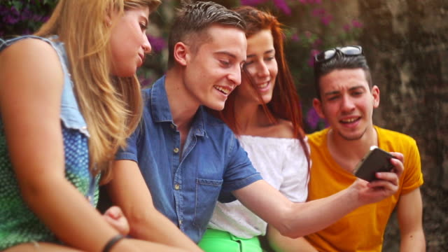 Group of teenager using a smart phone