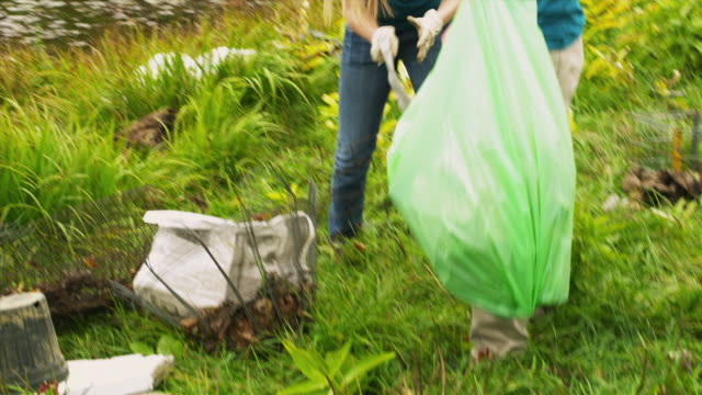MS SHAKY Group of teenagers cleaning lake shore from garbage, Dorset, Vermont, USA
