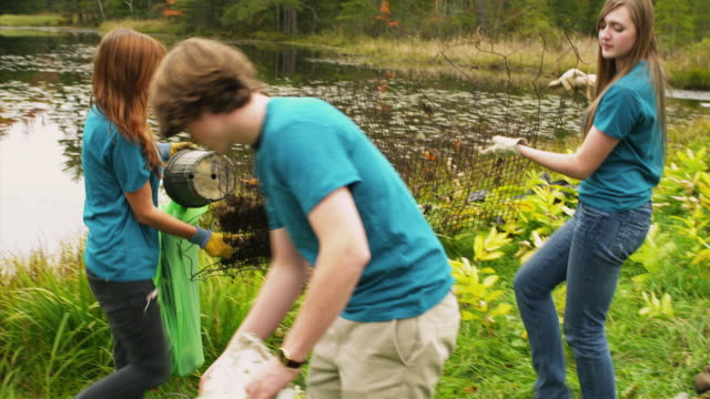 ms pan group of teenagers cleaning lake shore from garbage, dorset, vermont, usa - teenagers only stock videos & royalty-free footage
