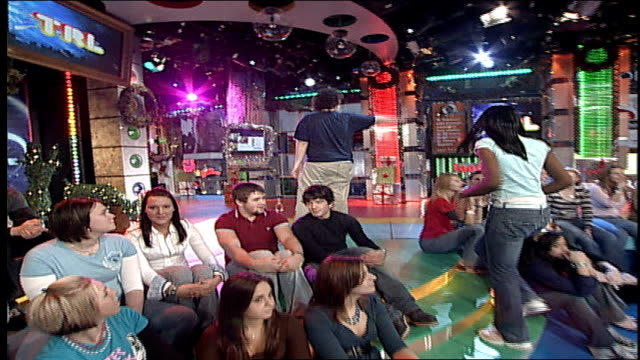 group of teenagers dancing in the trl studios during a commercial break - mtv1 stock videos & royalty-free footage