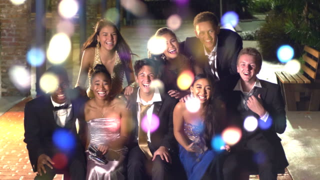 group of teenagers hanging out after prom - high school prom stock videos & royalty-free footage