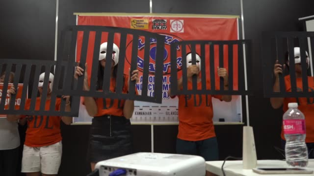 a group of teens portraying in a song and dance performance the good conduct time allowance controversies in philippine jail systems in a forum... - prison education stock videos & royalty-free footage