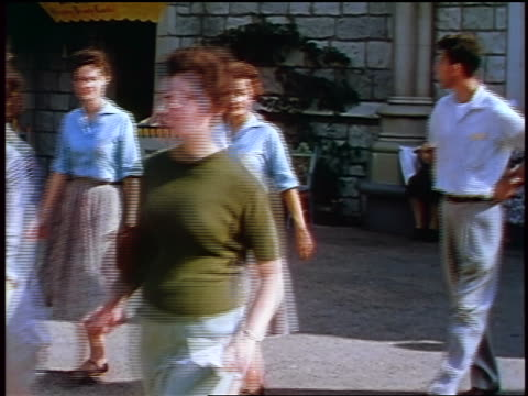 1957 group of teens walking past camera outdoors / feature - 1957 stock videos & royalty-free footage