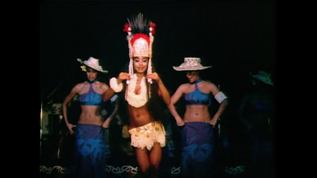 group of three women perform a hula dance routine in traditional clothing while on stage in hawaii in 1985. - pacific islanders stock videos & royalty-free footage