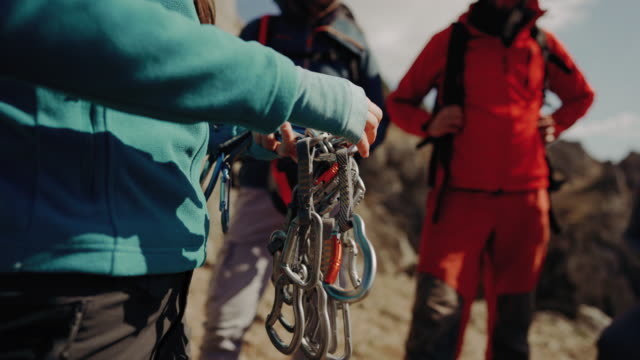 group of tourist preparing for an outdoor rock climbing - safety harness stock videos & royalty-free footage