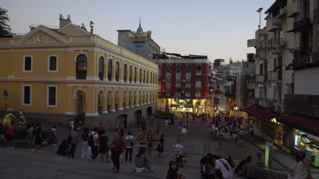 group of tourist taking photo and shopping at bakery and souvenir shops near ruins of st. paul's, macao. - ruins of st. paul's macao stock videos & royalty-free footage