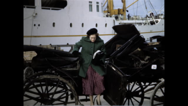 group of tourists step out of horse drawn carriage and smile at the camera with a ship in the background - passenger ship stock videos & royalty-free footage