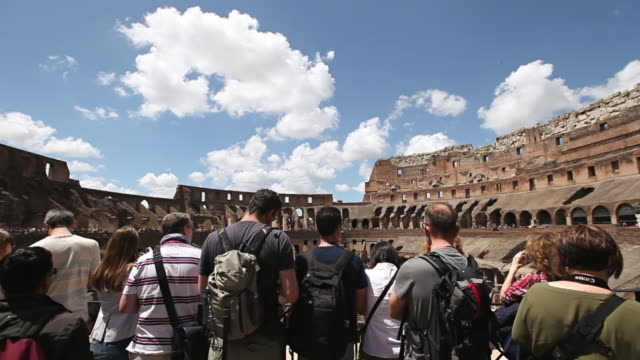 ws group of tourists visiting inside of coliseum / rome, italy - photographing stock-videos und b-roll-filmmaterial