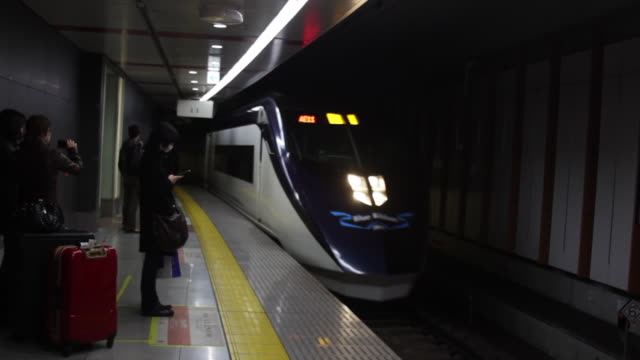 group of travelers wait to board a train pov tourism - nara prefecture stock videos and b-roll footage