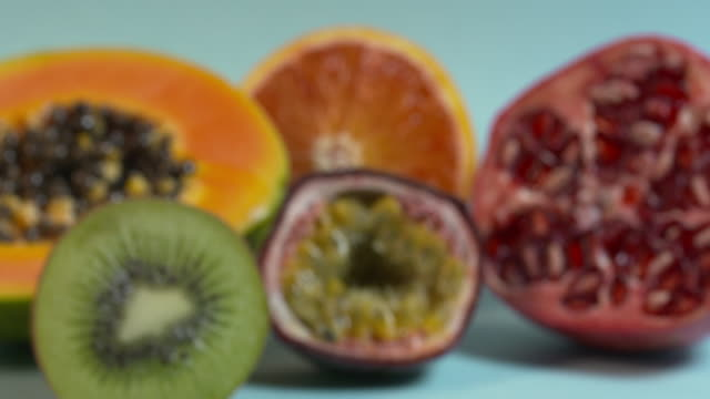 a group of tropical fruit comes into and goes out of focus. - papaya stock videos & royalty-free footage