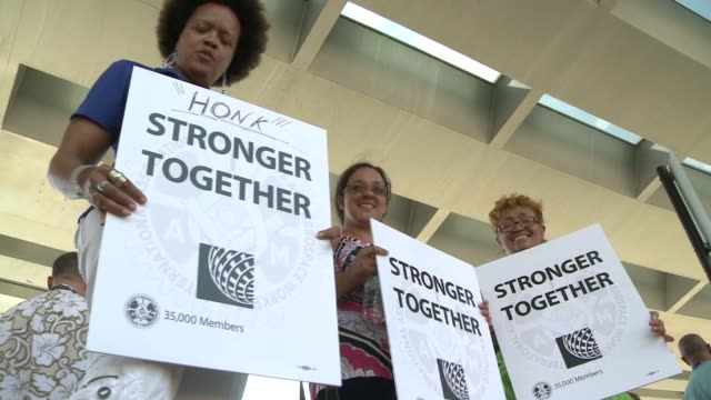 a group of united airlines union employees picketed at airport objecting to outsourcing jobs united airlines employees protest outsourcing at chicago... - outsourcing video stock e b–roll