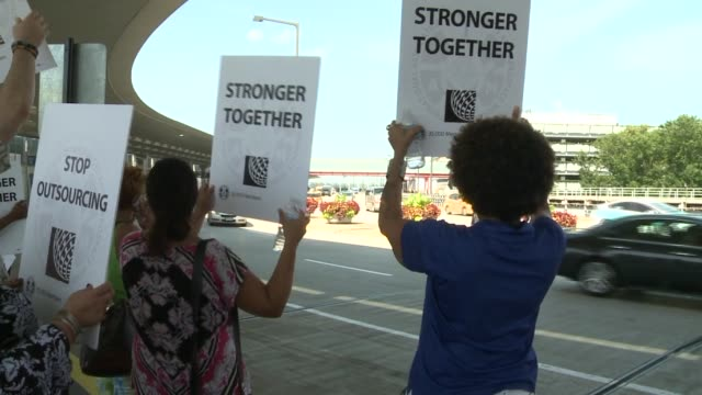 a group of united airlines union employees picketed at airport objecting to outsourcing jobs united airlines employees protest outsourcing at chicago... - outsourcing stock videos & royalty-free footage