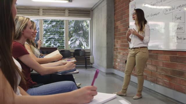 vidéos et rushes de ds, ms a group of university students at a class / medellin, colombia - amélioration